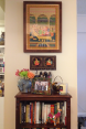 The first area I completed in my apartment--a little bookshelf key area where everything is so bright and colorful I can't help but be happy when I look at it.